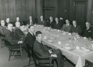 Board of Directors, A.G.Becker & Col, Inc. Mid -1966. Accross and around the table, from right to left: Herb Schaffner, Maury Cann, Roger Brown, Harry Weber, Mac Skall, Bill Mabie, Irv Sherman, James Becker, Paul Judy, Vince Flett, Don Pearson, Jack Connor, Jim Lewis, and Dave Heller.