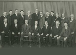 Board of Directors and Former Directors, A.G.Becker & Co., Inc. December, 1967.  Sitting, left to right: Jim Lewis, Don Pearson, Paul Judy, James Becker, Roger Brown, Jack Connor, Dave Heller; standing, left to right: Herb Schaffner, Ken Nelson, Mac Skall, Steve Weiss, Bill Mabie, John Mabie, Harry Weber, Dave Dattelbaum, Dick Gilder, Irv Sherman, Vince Flett, and Joe Levin.
