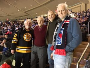 Paul Blaney (2017) (second from left) with sons at a Ranger's game.
